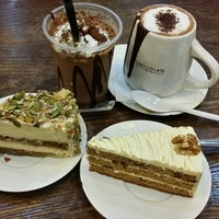 Photo taken at Theobroma Chocolate Lounge by Audrey T. on 4/10/2014