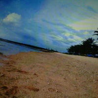 Photo taken at Pantai Ujung Genteng by Ayuniie M. on 5/22/2013