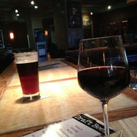 Photo taken at Bar Louie Anaheim by Carlos F. on 8/6/2013