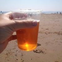 Photo taken at Sandy Bay Beach by Stuart W. on 7/12/2013