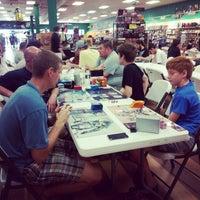 Photo taken at Dragon's Lair Comics by Alachia Q. on 8/10/2014