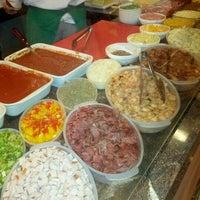Photo taken at Costa Mendes Delicatessen by Eduardo C. on 1/1/2013