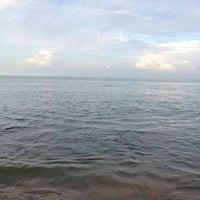 Photo taken at Pantai Teluk Kemang by Aida on 12/16/2012