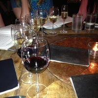 Photo taken at Vinoteca Wine Bar & Bistro by Erin O. on 4/14/2013
