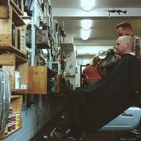 Photo taken at Maloney's Barber Shop by Richard H. on 1/30/2014