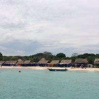 Photo taken at Playa Blanca by Sergio B. on 7/27/2013