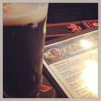 Photo taken at Ozzy's Sports Grill by Russell G. on 8/18/2013