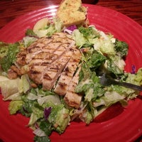 Photo taken at Red Robin Gourmet Burgers by Lauren A. on 4/14/2013