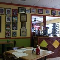 Photo taken at Azucar Restaurant & Bakery by Bill B. on 3/20/2013