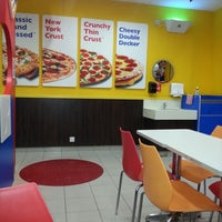 Photo taken at Domino's Pizza by Ila A. on 12/16/2012