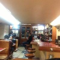 Photo taken at Café El Popular by Angel L. on 2/3/2013
