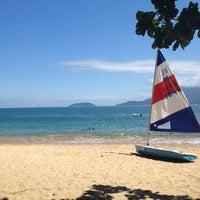 Photo taken at Praia do Curral by Gislaine L. on 4/1/2013
