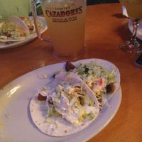 Photo taken at Fuego Cantina by Kayla J. on 10/31/2012