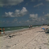 Photo taken at Pass-a-Grille Beach by Gina L. on 8/7/2011