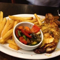 Photo taken at Nando's by Cherry C. on 7/15/2012
