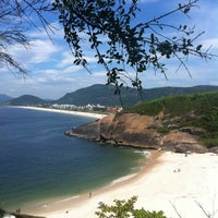 Photo taken at Praia do Sossego by Olho S. on 1/25/2013