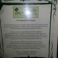 Photo taken at Mulligan's Irish Pub by Tracy B. on 6/26/2013