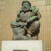 Photo taken at えびす像 by Tomomi K. on 4/29/2013