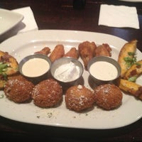 Photo taken at Houlihan's by @M@ND@ on 6/3/2013