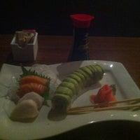 Photo taken at Manu's Tapas Bar & Sushi Lounge by Alex P. on 6/17/2013