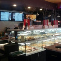 Photo taken at Sweet Hut Bakery & Cafe by Kenneth C. on 2/27/2013