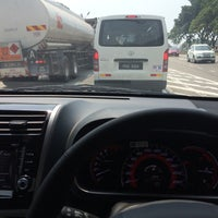 Photo taken at Bukit Minyak Intersection by Rezza M. on 7/25/2014