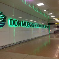 Photo taken at Don Mueang International Airport (DMK) by Reena J. on 7/10/2013