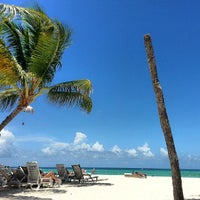 Photo taken at Los Corales Beach by Madelyn B. on 7/29/2013