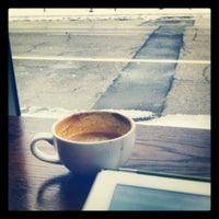Photo taken at Thirty-Thirty Coffee Company by Kyle J. on 2/27/2013