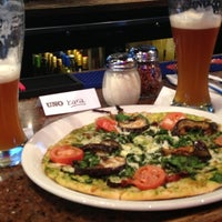 Photo taken at Uno Pizzeria & Grill - Victor by Sarah P. on 12/19/2012