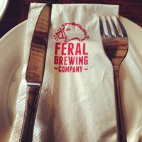 Photo taken at Feral Brewing Company by Thomas W. on 7/27/2013