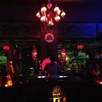 Photo taken at Taj Bar by Camille L. on 12/26/2012