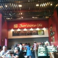 Photo taken at Juan Valdez Café by Caro V. on 11/24/2012