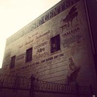 Photo taken at Alamo Music Center by Ben O. on 5/29/2013