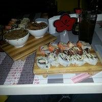 Photo taken at Ikura Sushi-Bar by Carolina P. on 2/27/2013