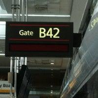 Photo taken at Gate B42 by Dustin C. on 3/17/2013