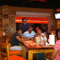 Photo taken at Hooters by Camilo T. on 12/23/2012