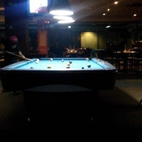Photo taken at Rick's Cafe & Billiard by Mario B. on 9/19/2014