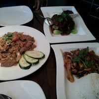 Photo taken at Osha Thai Restaurant by Nicole R. on 7/25/2013