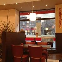 Photo taken at Junge.lv konditoreja by Ira L. on 12/27/2012