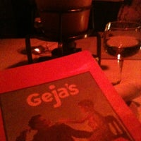 Photo taken at Geja's Cafe by Maggie B. on 3/6/2013