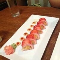 Photo taken at Manu's Tapas Bar & Sushi Lounge by Karen R. on 7/12/2013