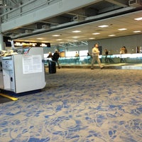 Photo taken at Concourse E by Michelle L. on 2/28/2013