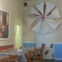 Photo taken at Mykonos Taverna by Lauryn V. on 12/19/2012