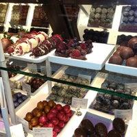 Photo taken at Godiva Chocolatier by Mrs. E. on 3/22/2013
