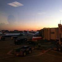 Photo taken at Gate T12 by Emily O. S. on 1/3/2014
