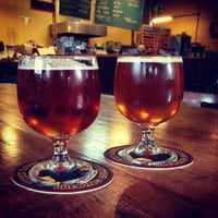 Photo taken at Lucky Labrador Beer Hall by Jim O. on 3/23/2015