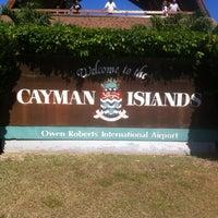 Photo taken at Owen Roberts International Airport (GCM) by Juan Pablo C. on 2/16/2013