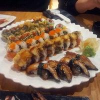 Photo taken at Sushi Rock by Matthew J. on 1/2/2013