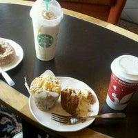 Photo taken at Starbucks by Carolynn W. on 1/1/2012